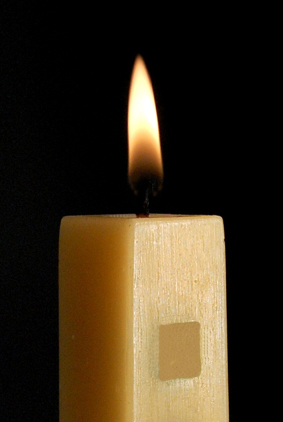 Beeswax candle burning