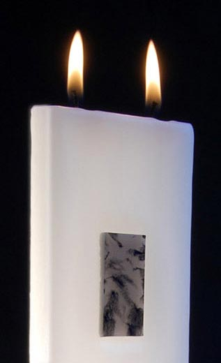 Two wicked tablet candle burning